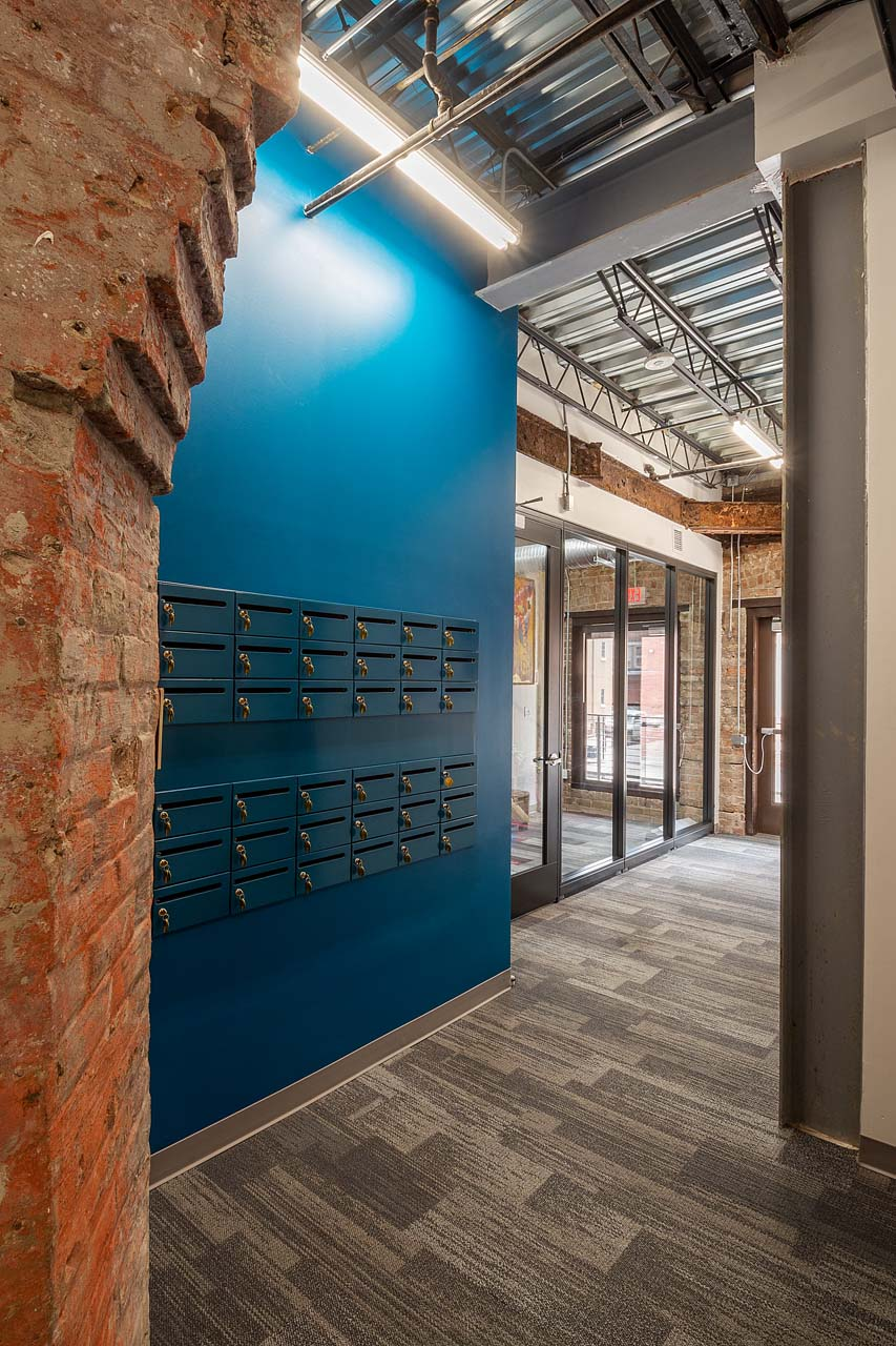 View of mailboxes for rent and reception area door.